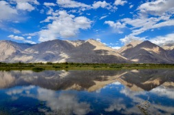 Wonderful reflection of the mountains on the way to Nurba valley. Siachin is far behind these mountains